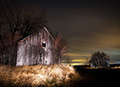 ligthpainting on barn at night in Quebec, Canada