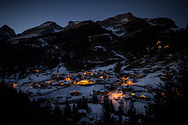 swiss village in mountains at night