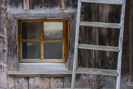 chalet window and wooden scale